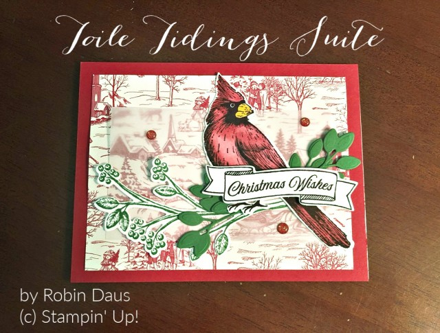 Card of a red cardinal setting on a table