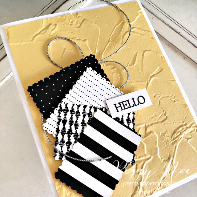 Quick & Easy Handmade Card using Stampin' Up! Pattern Party Paper created by Peggy Noe of Pretty Paper Cards #peggynoe #prettypapercards #patternparty #patternpartypaper #rectanglepostagestamppunch #paintedtextureembossingfolder #stampinup #stampingup #easyhandmadecard #black&white #hellocard #blackwhiteyellowcard #blackwhiteyellow