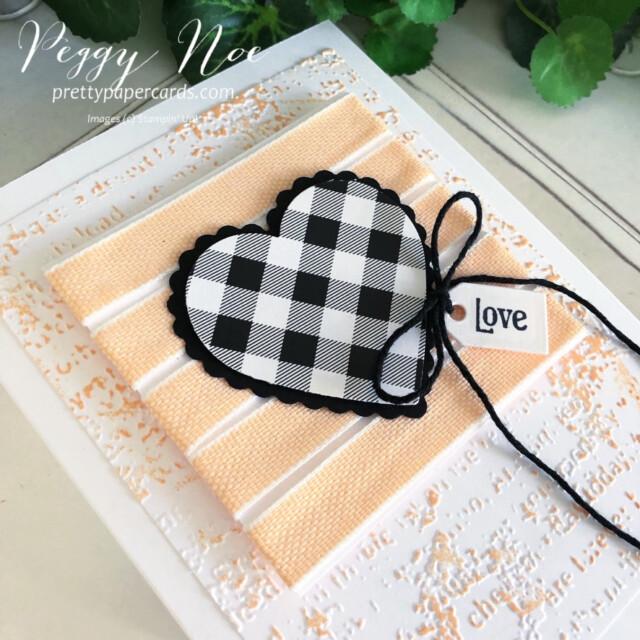 Handmade Love Card made with the Stampin' Up! Heart Punch Pack created by Peggy Noe of Pretty Paper Cards #GDP304 #heartpunchpack #quietmeadowbundle #peggynoe #prettypapercards #prettypapercards.com #stampinup #stampingup #palepapayaribbon #palepapaya #timeworntype #timeworntypeembossingfolder #lovecard #checkeredheart